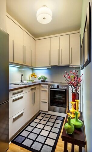 A small kitchen space, painted white, can help it seem larger.