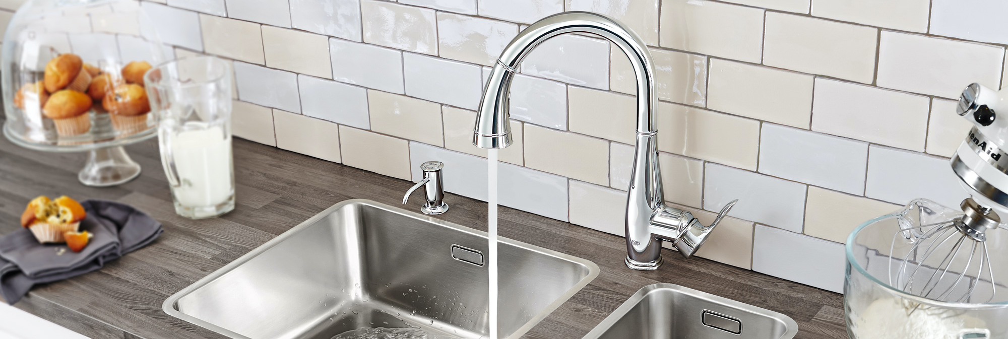 Faucet with water running in kitchen