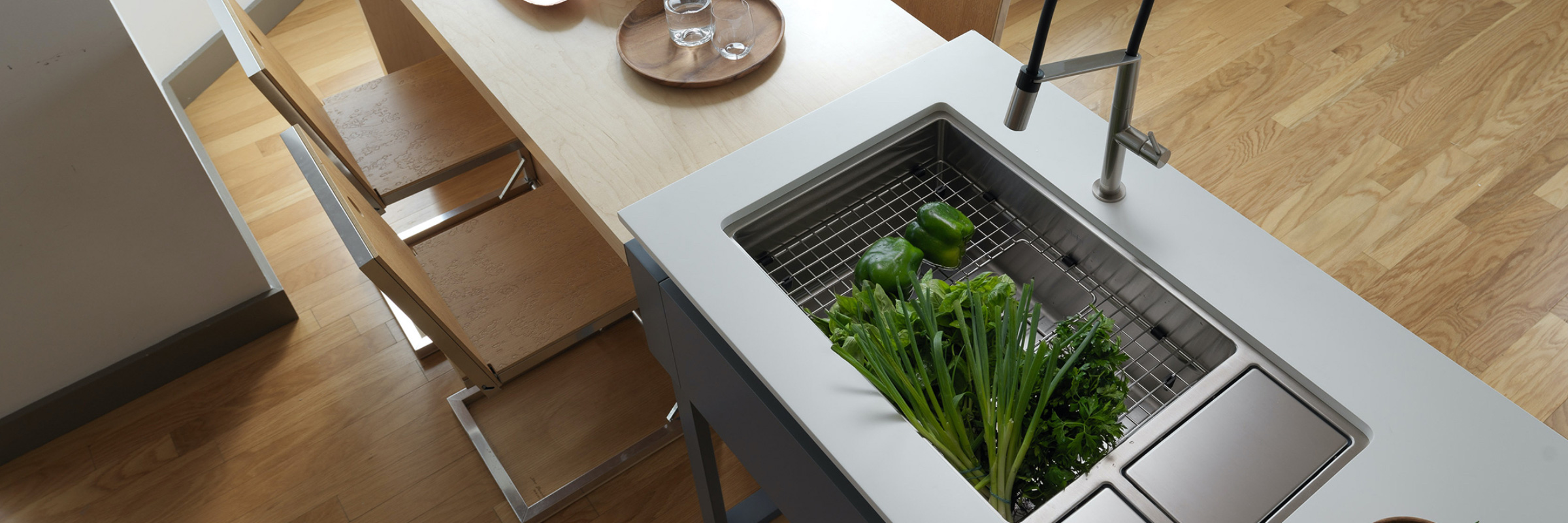 Kitchen concept with fresh vegetables in the sink