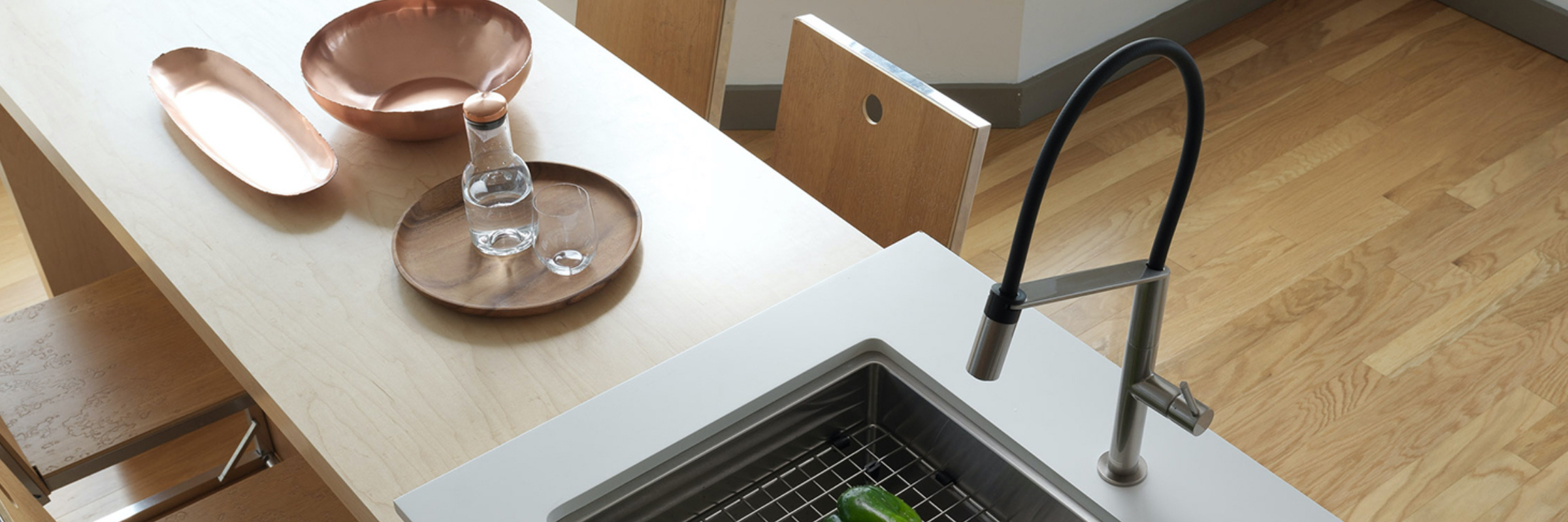 Kitchen concept with faucet and wooden countertop
