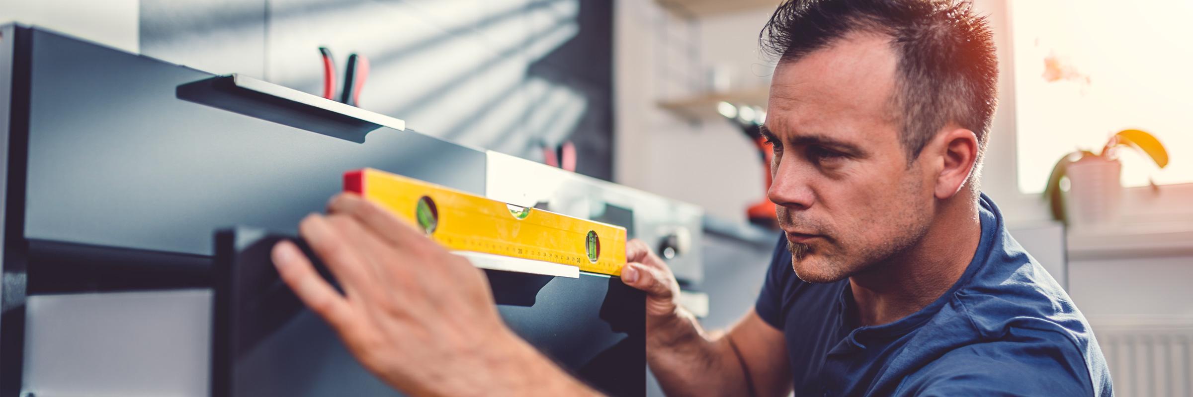 Man measuring a drawer